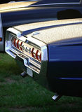Chrome and Taillights. A rainy rear end of an american classic car parked on a power meet in Sweden Stock Images