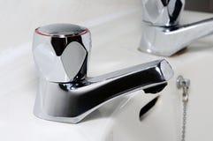 Chrome tap on bathroom sink. Stock Photography