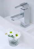 Chrome tap water and flower Royalty Free Stock Photo