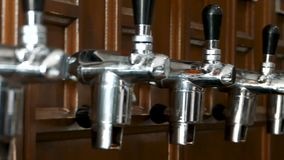 Chrome taps for pouring beer. Beer bottling plant. Slow motion. Video stock video