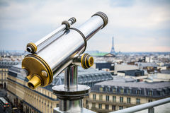 Chrome telescope over Paris landscape on Lafayette Gallery terrace Royalty Free Stock Image