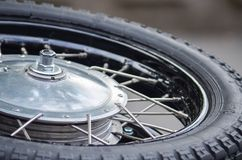 Chrome tire of vintage motobike. Vintage motobike tire with copy space for text Stock Images