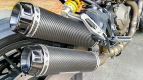Chrome, Tire, Wheel, Coiled Spring, Mode of Transport. Closeup of exhaust or intake of racing motorcycle. Low angle photograph of motorcycle Royalty Free Stock Photos