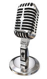 Chrome vintage microphone. Close up of chrome vintage microphone on stand against white royalty free stock photography