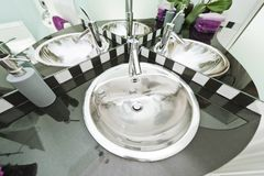 Chrome washbasin mirroring multiple times stock images