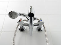 Chrome water tap in white bathroom Stock Photography