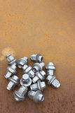 Chrome wheel nuts Stock Photography