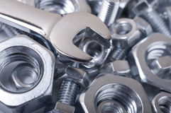 Chrome wrench on nuts and bolts Royalty Free Stock Photos