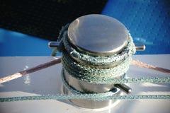 Chromed bollard. The close-up of a chromed ship`s pillar of a ship`s wall Stock Photos