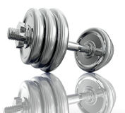 Chromed dumbbell in close up side view. Stock Photo