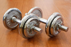 Chromed dumbbell weight Royalty Free Stock Photography