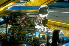 Chromed Engine. Car - chromed engine - blower - nitrous - in bright yellow car Stock Photography