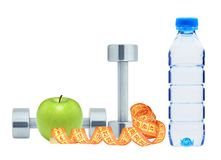 Chromed fitness dumbbells, measure tape and green apple isolated. On white background Royalty Free Stock Photo