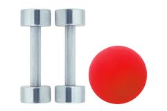 Chromed fitness dumbbells and red ball isolated on white Stock Photos