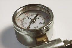 Chromed gauge high air gas pressure sensor meter close-up white background.  Stock Photo