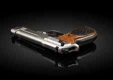Chromed handeldvapen på svart bakgrund Royaltyfri Fotografi