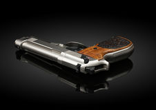 Chromed handgun on black background. With reflection Royalty Free Stock Photography