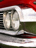 Chromed Headlights. Closeup of headlights and chrome on an american classic car Royalty Free Stock Photography