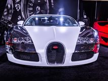 Chromed out bugatti on display as well as a black bentley stock photo