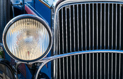 Chromed plated old car front light and radiator Stock Photos
