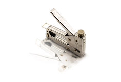 Chromed stapler for fastening a mirror image Royalty Free Stock Image