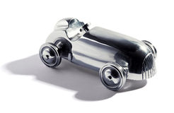 Chromed vintage toy car. Chromed silver vintage two sealer open sports car toy with integral wheels, on a white background with shadow Royalty Free Stock Photos