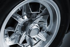 Chromed wheel disc. Luxury vintage car. Fragment, close up photo with selective soft focus Royalty Free Stock Image