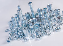 Chromeplated bolts and nuts Royalty Free Stock Photos