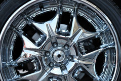 The chromeplated rim of a wheel Stock Image