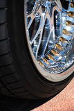 The chromeplated rim of a wheel Royalty Free Stock Photo