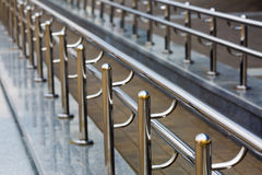 Chromium metal handrail. Chromium metal fence with handrail. Chromium metal railings. Shallow depth of field. Selective focus royalty free stock image