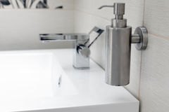 Chromium-plate tap on white sink. Stock Images