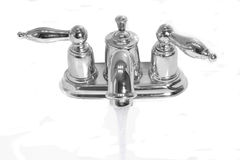 Chromium water tap with flowing water Royalty Free Stock Images