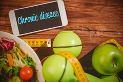 Chronic disease against phone on healthy persons desk Royalty Free Stock Image