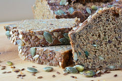 Chrono bread with seeds, side view. Chrono, organic, unleavened bread with various seeds, pumpkin, sunflower, flax seeds, delicious and very healthy, on the Royalty Free Stock Photos