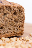 Chrono bread on a wooden board with grains of wheat.  Royalty Free Stock Image