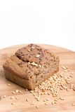 Chrono bread on a wooden board with grains of wheat.  Royalty Free Stock Photography