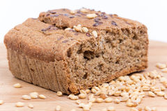 Chrono bread on a wooden board with grains of wheat.  Stock Photo