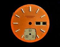 Chrono dial. Aged orange watch chrono dial Stock Photo