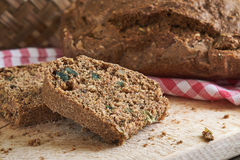 Chrono diet bread. Homemade chrono diet bread on wooden cutting board Royalty Free Stock Photo