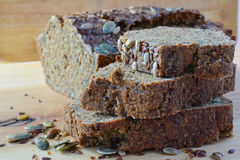 Chrono, organic, unleavened bread with various seeds. Pumpkin, sunflower, flax seeds, delicious and very healthy, side view, close up Stock Photo