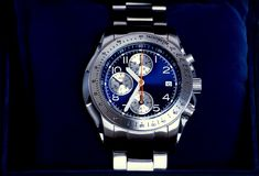 Chronograph watch. In blue box Stock Image