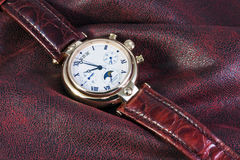 Chronograph watches are on the fabric Royalty Free Stock Photography