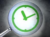 Chronologieconcept:  Klok met optisch glas op digitale backgroun Royalty-vrije Stock Fotografie