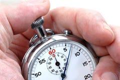 Chronomètre dans une main Photographie stock