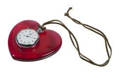 Chronomètre et coeur rouge sur la corde en cuir Photo stock