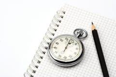 Chronomètre et crayon lecteur Photographie stock libre de droits