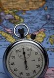 Chronomètre sur la carte Image stock