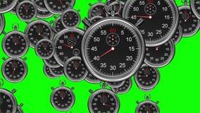 Chronomètres tombant sur le fond vert illustration stock