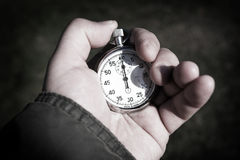 Chronometer. In the hand close up Stock Images